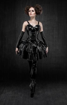 Brunette in fetish latex dress