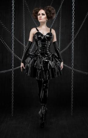 latex: Brunette in fetish latex dress