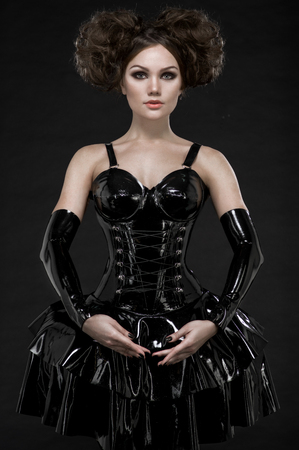 Sexy woman brunette in fetish latex dress and chains