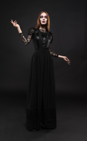 Portrait of gothic girl with black eyes in dark clothes Stok Fotoğraf