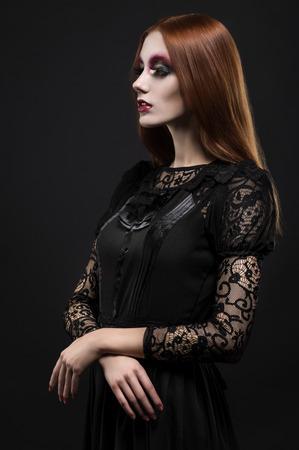 ojos negros: Portrait of gothic girl with black eyes in dark clothes Foto de archivo