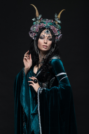 Beautiful fantasy elf woman in floral crown and medieval dress