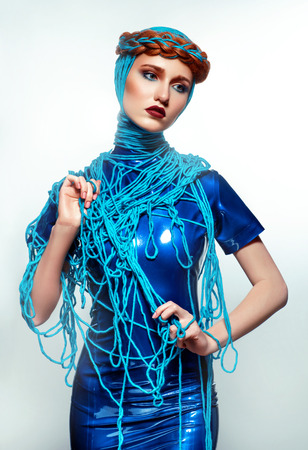 beautiful redhead: Portrait of beautiful redhead woman with blue threads