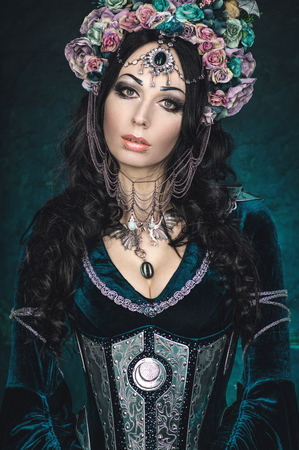 elf: Beautiful fantasy elf woman in floral crown and medieval dress