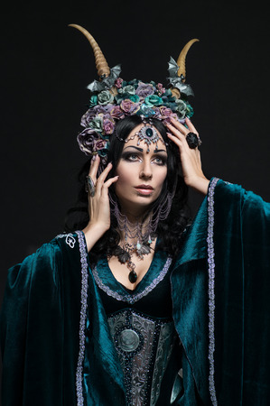 medieval dress: Beautiful fantasy elf woman in floral crown and medieval dress