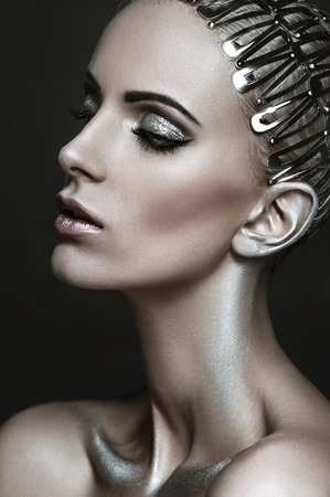 glamour nude: Beautiful portrait of a woman with silver makeup and hair clips on hair