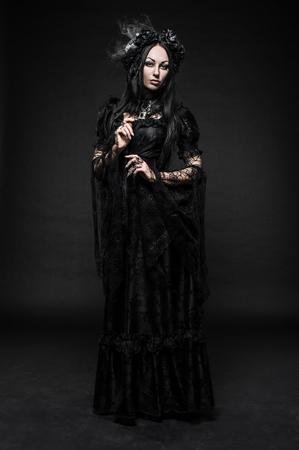 Portrait of beautiful Gothic woman in dark dress in studio 免版税图像 - 49131007