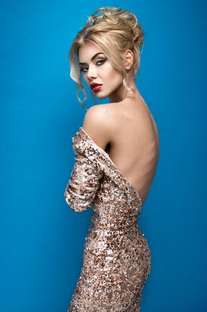 Young woman in beautiful dress in studio