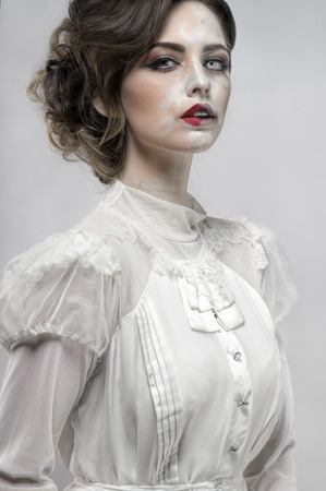 Sexy woman in white long retro dress