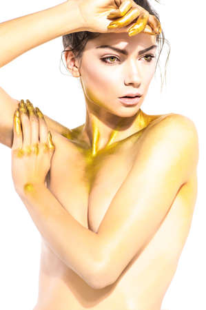 jewelle: Portrait of beautiful young woman with golden body art Stock Photo