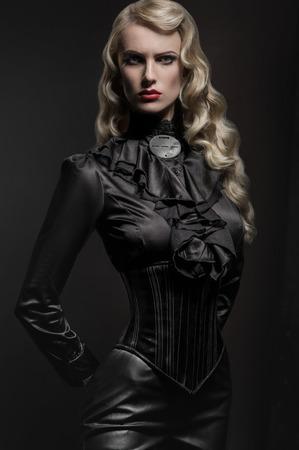 dominatrix: Beauty portrait of woman in military hat