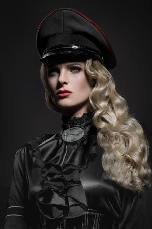 Beauty portrait of woman in military hat