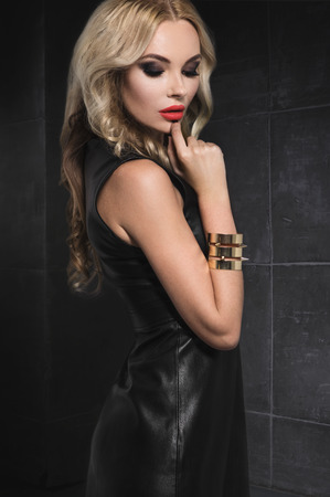 Blond woman in black leather dress