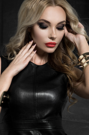 latex fetish: Blond woman in black leather dress