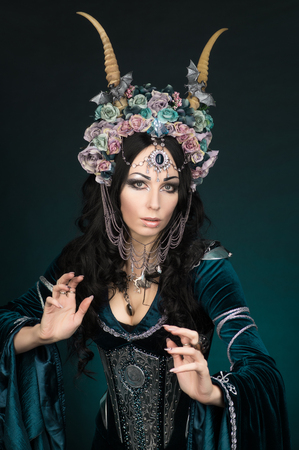 medieval dress: Beautiful fantasy elf woman in flower crown and medieval dress