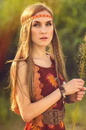 teen love: Girl in national dress on nature