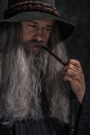 exorcist: Old sorcerer with a wooden staff