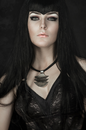 gothic woman: Portrait of a pale gothic woman in black