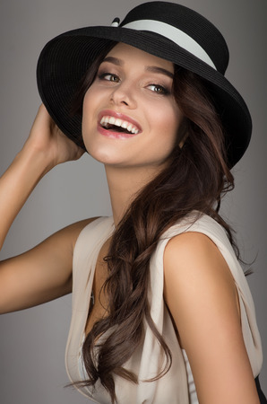 Elegant fashion tender young model woman in hat studio