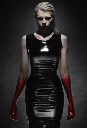 latex fetish: Portrait of pale woman in black latex dress