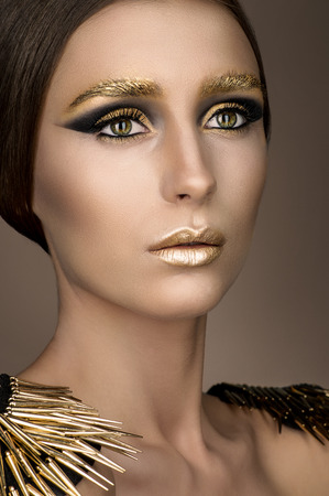 Beauty woman with gold make-up