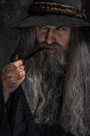 abracadabra: Portrait of old sorcerer in hat Stock Photo