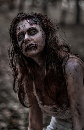 young woman face: Zombie woman with wounds Stock Photo