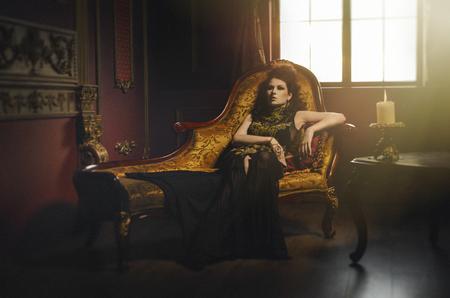 Decadent woman lying on the sofa