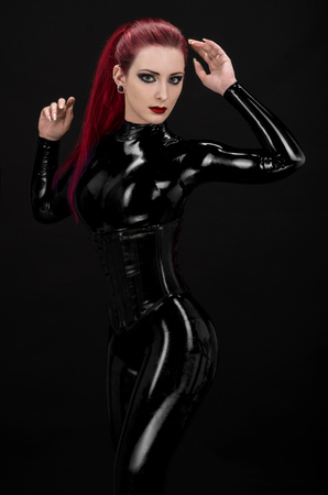 latex woman: Sexy woman in black latex suit