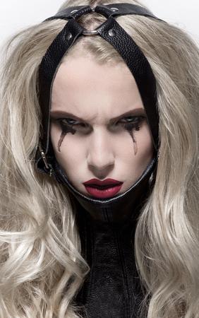 Portrait of blonde woman in BDSM neck collar Stock Photo