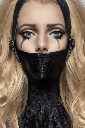 Portrait of blonde woman in BDSM neck collar Stock Photo