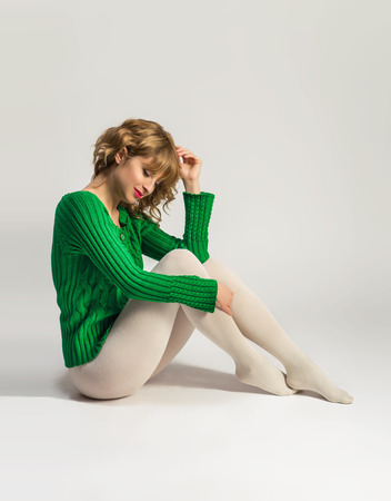 tights: Woman in white tights over white background