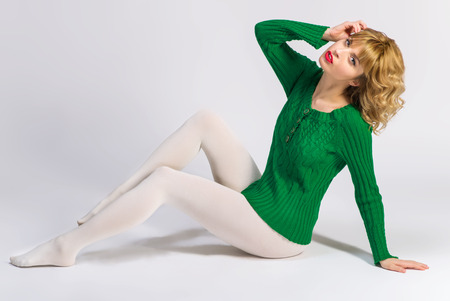 sock: Woman in white tights over white background