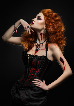 lady in red: Gothic redhead beauty  with wounds Stock Photo