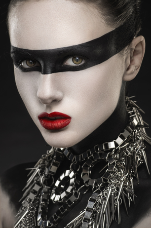 faceart: Woman with face-art and necklace Stock Photo