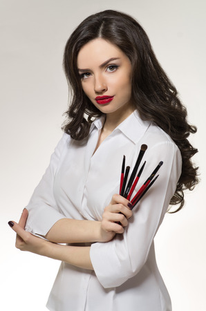 Beauty salon makeup artist with professional brushes Stock fotó