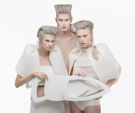 three persons: Three persons in white outfit over white background