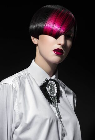 color model: Dark portrait of pale gothic woman with creatively dyed hair Stock Photo