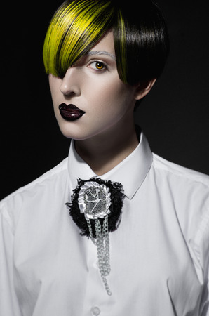 vibrance: Dark portrait of pale gothic woman with creatively dyed hair Stock Photo