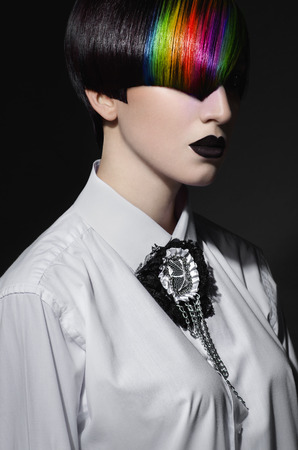 gothic woman: Dark portrait of pale gothic woman with creatively dyed hair Stock Photo