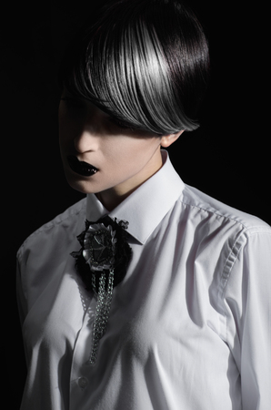dyed hair: Dark portrait of pale gothic woman with creatively dyed hair Stock Photo