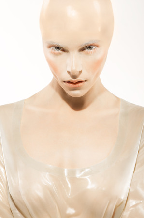 bald girl: Conceptual fashion shot with bald girl in latex outfit Stock Photo