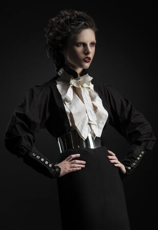 frill: Fashion shot of a woman in a strict black suit Stock Photo
