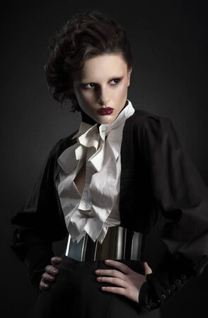 vamp: Fashion shot of a woman in a strict black suit Stock Photo