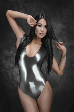 latex woman: Sexy brunette woman in latex swimsuit