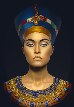 Woman with golden skin in Egyptian style 写真素材