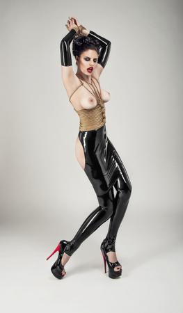 gothic fetish: Sexy woman in rope bandage Stock Photo