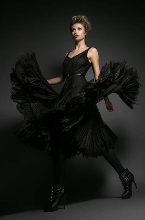 avantegarde: Fashion model in black dress
