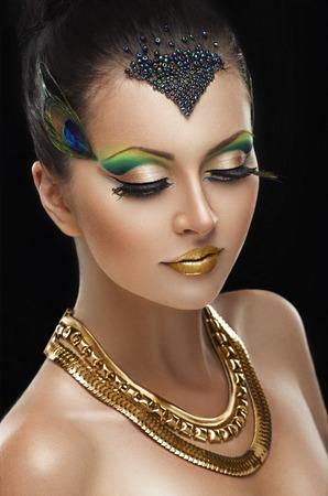 Woman with golden makeup