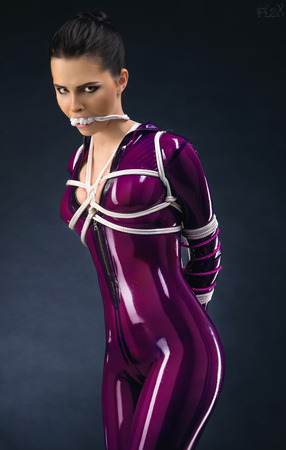 Sexy woman in latex outfit and rope